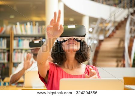 Group Of Adult Students Using Vr Simulators For Studying. Man And Woman In Virtual Reality Glasses S
