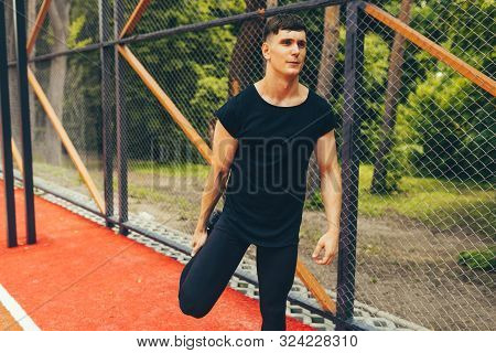 Image Of Althelte Muscular Young Man Doing Core Workout On Sportsground. Caucasian Fitness Male Exer