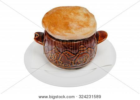 Beef Stew In A Crock Pot, Covered With A Circle Of Baked Dough On White Isolated Background