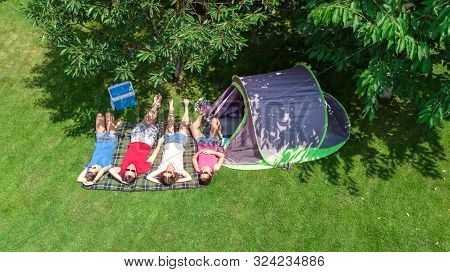 Family Vacation In Campsite Aerial Top View From Above, Parents And Kids Relax And Have Fun In Park,