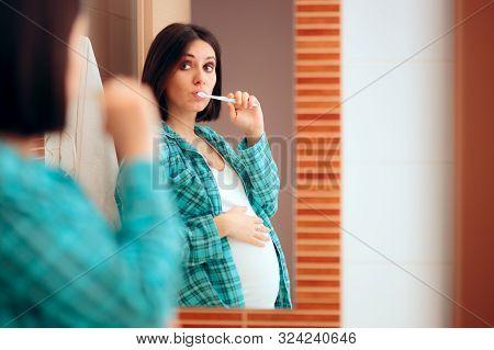 Pregnant Woman Wearing Pajamas Brushing Her Teeth