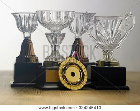 crystal trophy and medal on the gray background