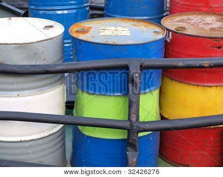 Color photograph of steel drums with gasoline