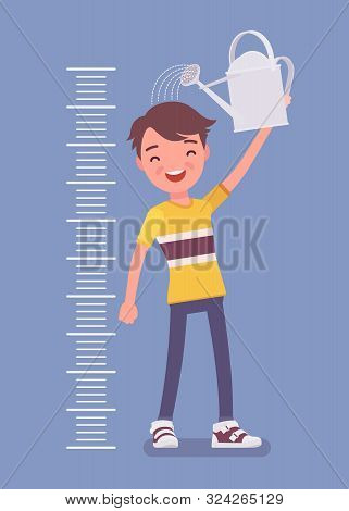 Boy At Child Height Growth Chart With Watering Can. Happy Schoolboy Pouring Water Over His Head To G