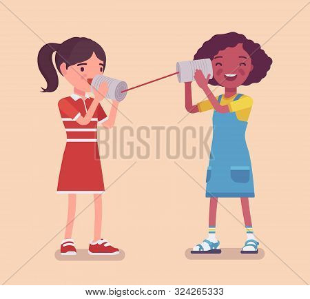 Girls Speaking By Tin Can Telephone. Two Friends Playing In Phone With Self Made Speech Transmitting