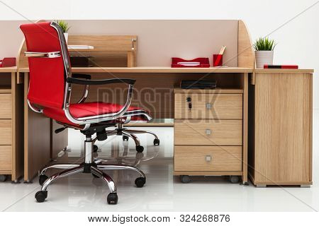 table and chair against the background of a white wall in the office