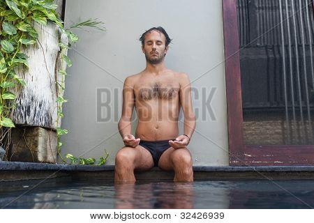 Man With Feet In Pool