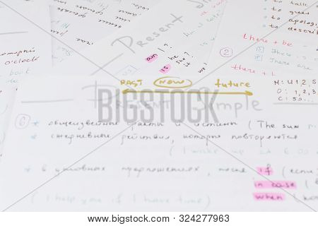 Close-up Handwriting English Grammar Rules On White Sheet Of Paper