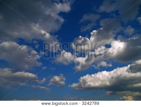 Clouds In A Deep Blue Sky.