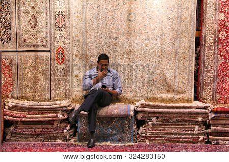 Dubai, Uae - November 23, 2017: Persian Carpet Seller At Souk Madinat Jumeirah In Dubai. The Traditi