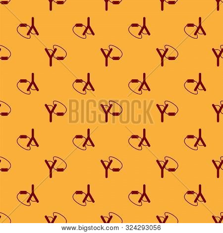 Red Slingshot Icon Isolated Seamless Pattern On Brown Background. Vector Illustration