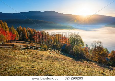 Amazing Countryside In Fall Season At Sunrise. Gorgeous View In To The Valley Full Of Fog In Morning