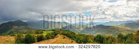Panoramic Mountain Landscape In Autumn. Colorful Scenery On A Sunny Day. Changing Weather With Cloud
