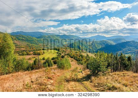 Beautiful Mountain Landscape In Autumn. Colorful Scenery On A Sunny Day. Changing Weather With Cloud