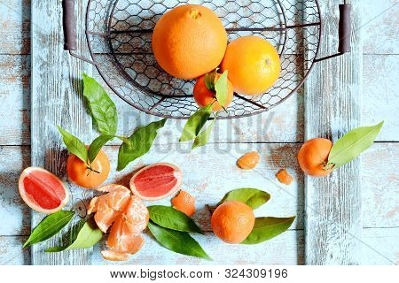 Tangerines (oranges, Mandarins, Clementines, Citrus Fruits) With Leaves In Basket On A Mint (blue) B