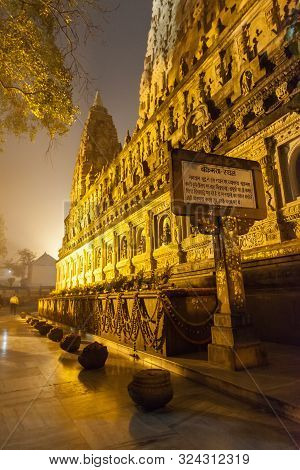The Place Of An Enlightenment Of Buddha, Mahabodhi Temple And Stupas In Beams Of Night Illumination