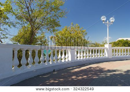 View On White Stone Fence With Balusters From Black Sea Promenade On Sunny Early Autumn Day In Velve