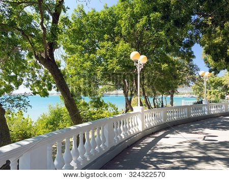 View On Blue Water In Sea Bay Through White Stone Balustrade From Promenade On Sunny Day In Velvet S