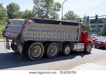 A City In The Usa. Truck (dumper) In Urban Traffic.