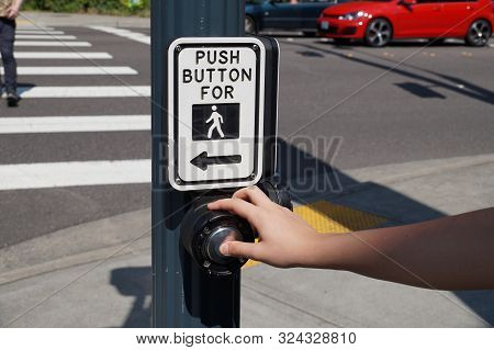 Pedestrian Presses The Button. A Pedestrian Light Switch With Voice Guidance And Comprehensive Opera