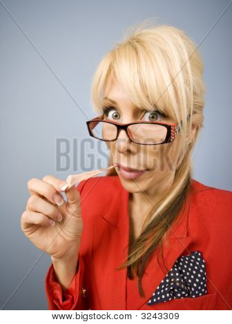 Woman In Red With Gum Making A Funny Face