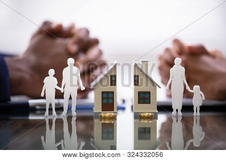 Wife And Husband Splitting Children And House During Divorce Process