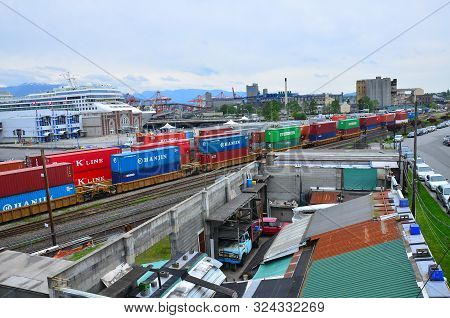 Vancouver, Canada 05/08/2014 - Container Port With The City On The Background. Containers Boxes Read