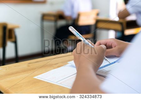 English Exams Test Student In School, University Students Holding Pencil For Testing Exam Writing An
