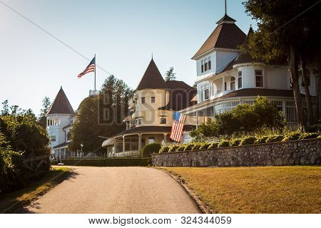 Mackinac Island Mi /usa - July 9th 2016: Victorian Houses On The West Bluffs Behind The Grand Hotel