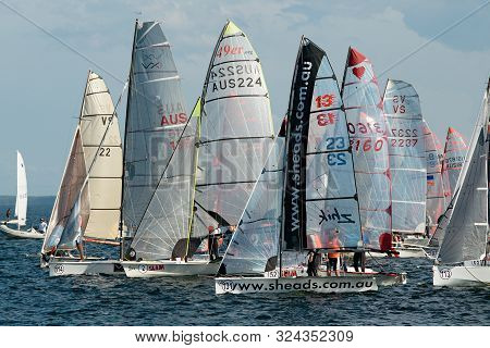 Lake Macquarie, Australia - April 18, 2013: School Children Sailing Competing In The Australian High