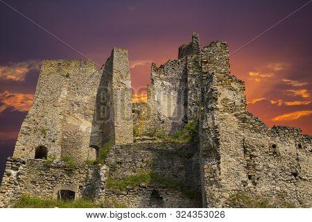 Scenic Ruins Of Ancient Castle  Likava Outside On Blue Cloudy Sky Background. Liptov Region. Slovaki