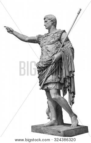 Caesar Augustus, the first emperor of Ancient Rome. Bronze monumental statue in the center of Rome isolated on white background by clipping path