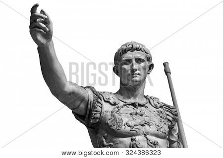 Caesar Augustus, the first emperor of Ancient Rome. Bronze monumental statue in the center of Rome isolated on white background