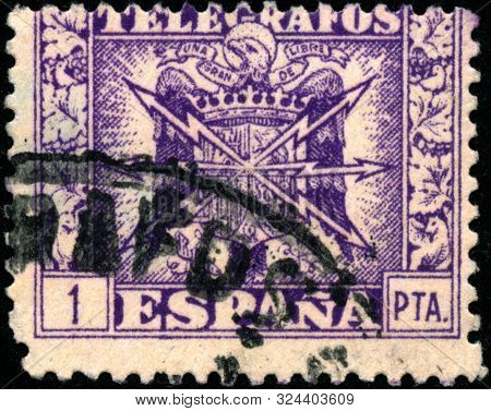 Vintage Stamp Printed In Spain 1940 Shows Coat Of Arms And The Word Telegrafos