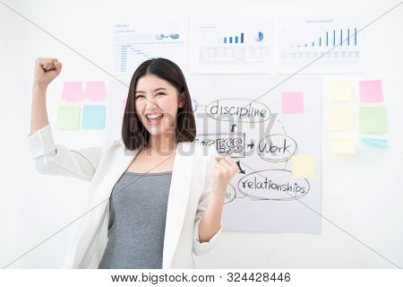 Successful Business Asian Woman Holds Her Arms Up After The Great Presentation Feeling Triumphant An