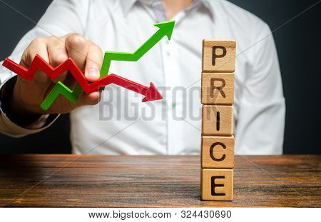 A Man Holds A Red And Green Arrow And Predicts A Price Change. Price Regulator, Controller. Supply-d
