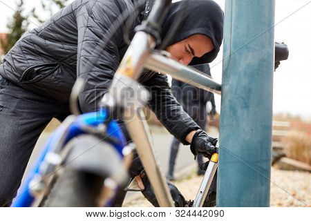 Bicycle theft in the city with thief and bike