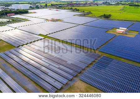 Solar Energy Farm Producing Clean Renewable Energy From The Sun . Thousands Of Solar Panels, Photovo