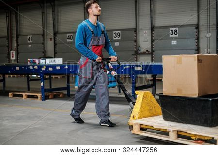 Warehouse worker with a pallet rack