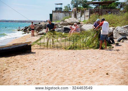 Kerch, Russia - 5 August 2019: Fishermen On Beach In Kerch