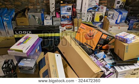 Wrexham, Uk - January 24, 2019: Various Appliance And Product Boxes Stored In A Home Attic. Messy Ho