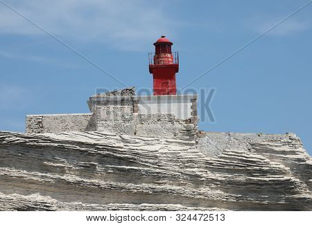 Red Lighthouse On The Cliff Near The Bonifacio Town In Corsica In Europe
