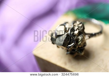 Beautiful Silver Ring With Pyrite Gemstones On Color Background. Space For Text