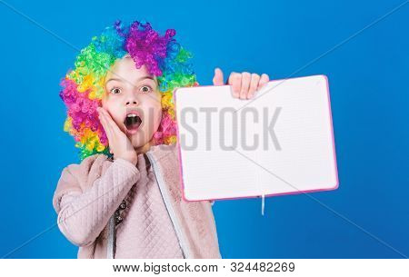 Using Her Imagination. Little Girl In Colorful Hair Wig With Surprised Face And Bright Imagination H