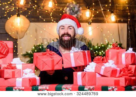 Happy Winter Holidays. Lot Of Gifts. Hipster Prepared Gifts For Family. Man Santa Claus Hat Celebrat