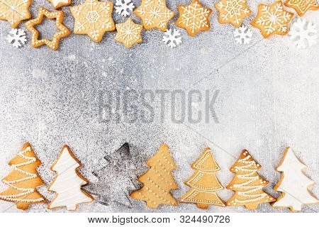 Christmas Pattern Of Gingerbread Cookies In The Shape Of Christmas Tree And Snowflakes On Light Gray
