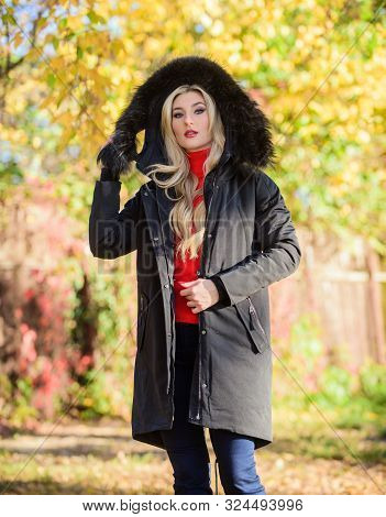 Puffer Jacket With Hood. Woman Wear Black Parka Fur Hood. Classic Parka Coat Has Become Wardrobe Ico