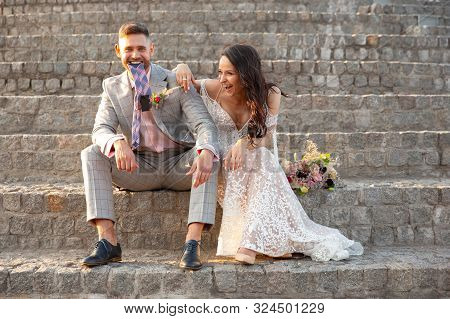 Caucasian Romantic Young Couple Celebrating Marriage In City. Tender Bride And Groom On Modern Citys