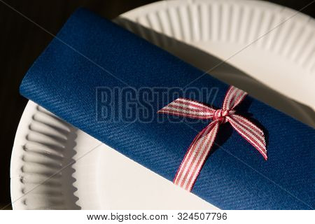 Recycleable Paper Plate And Blue Paper Cloth Napkin Wrap With Red-white Striped Bow