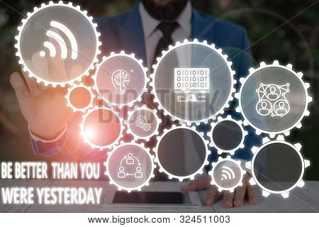 Conceptual hand writing showing Be Better Than You Were Yesterday. Business photo text try to improve yourself everyday Male wear formal work suit presenting presentation smart device. poster